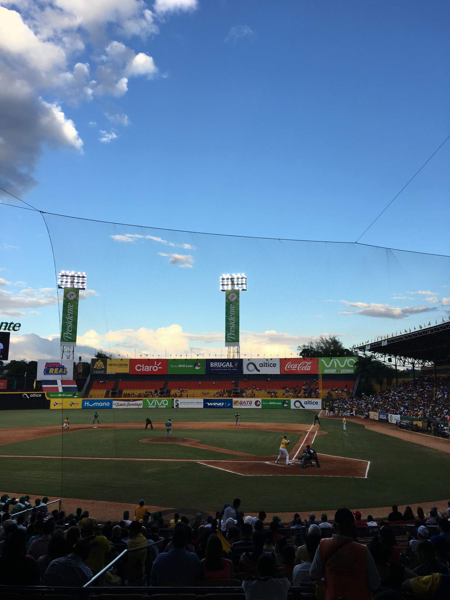 Watching a baseball game at the Cibao stadium, Santiago, Dominican Republic