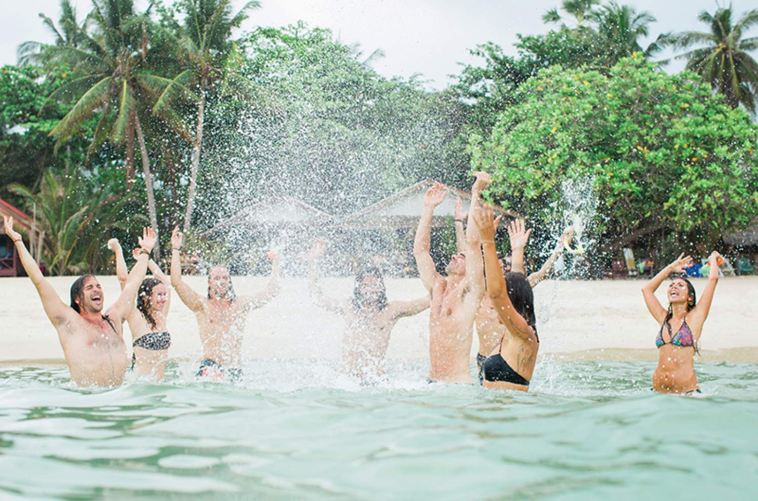 Swimming in the sea at a destination wedding