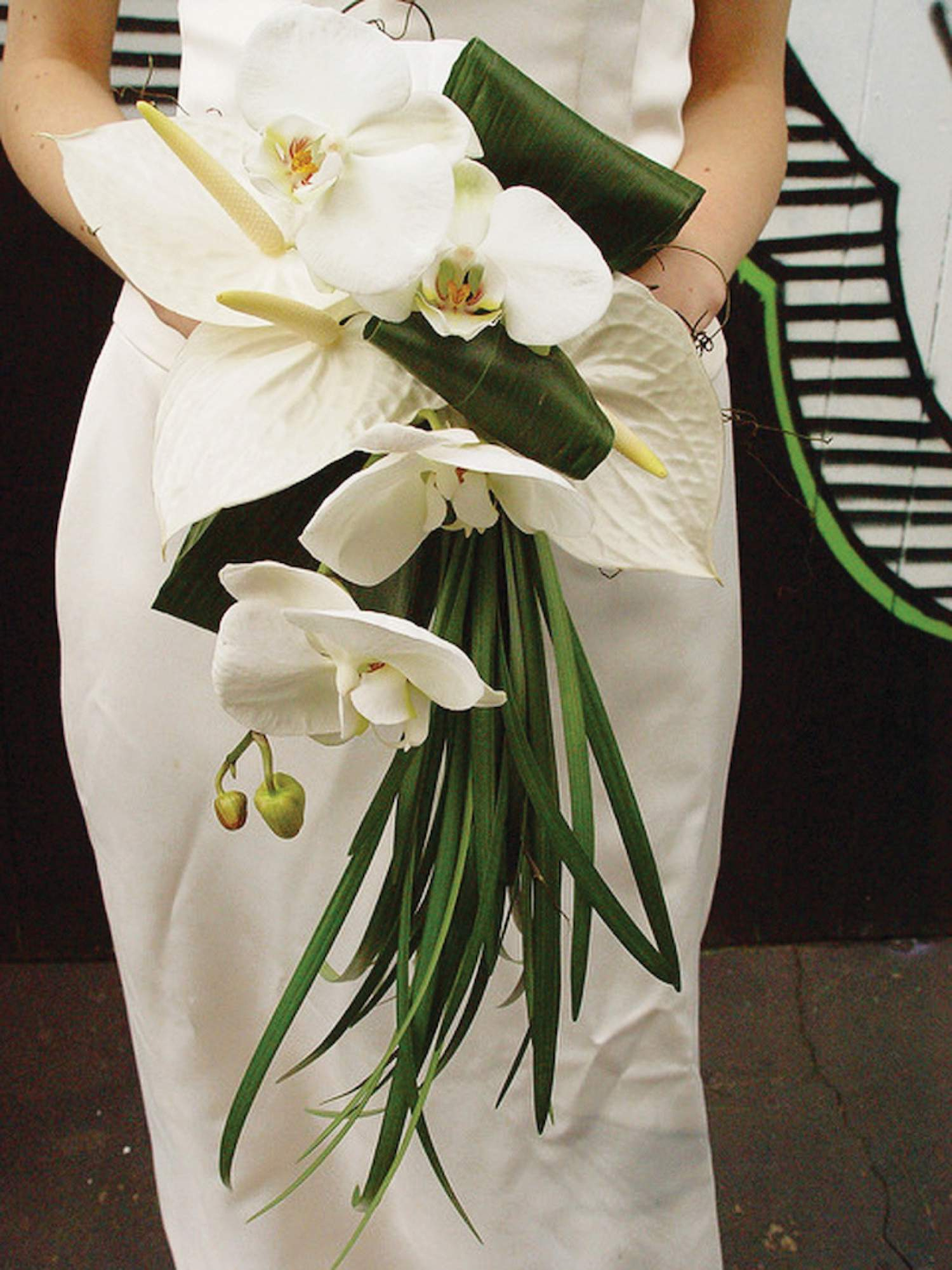 White orchids and calla bouquet for a beach wedding