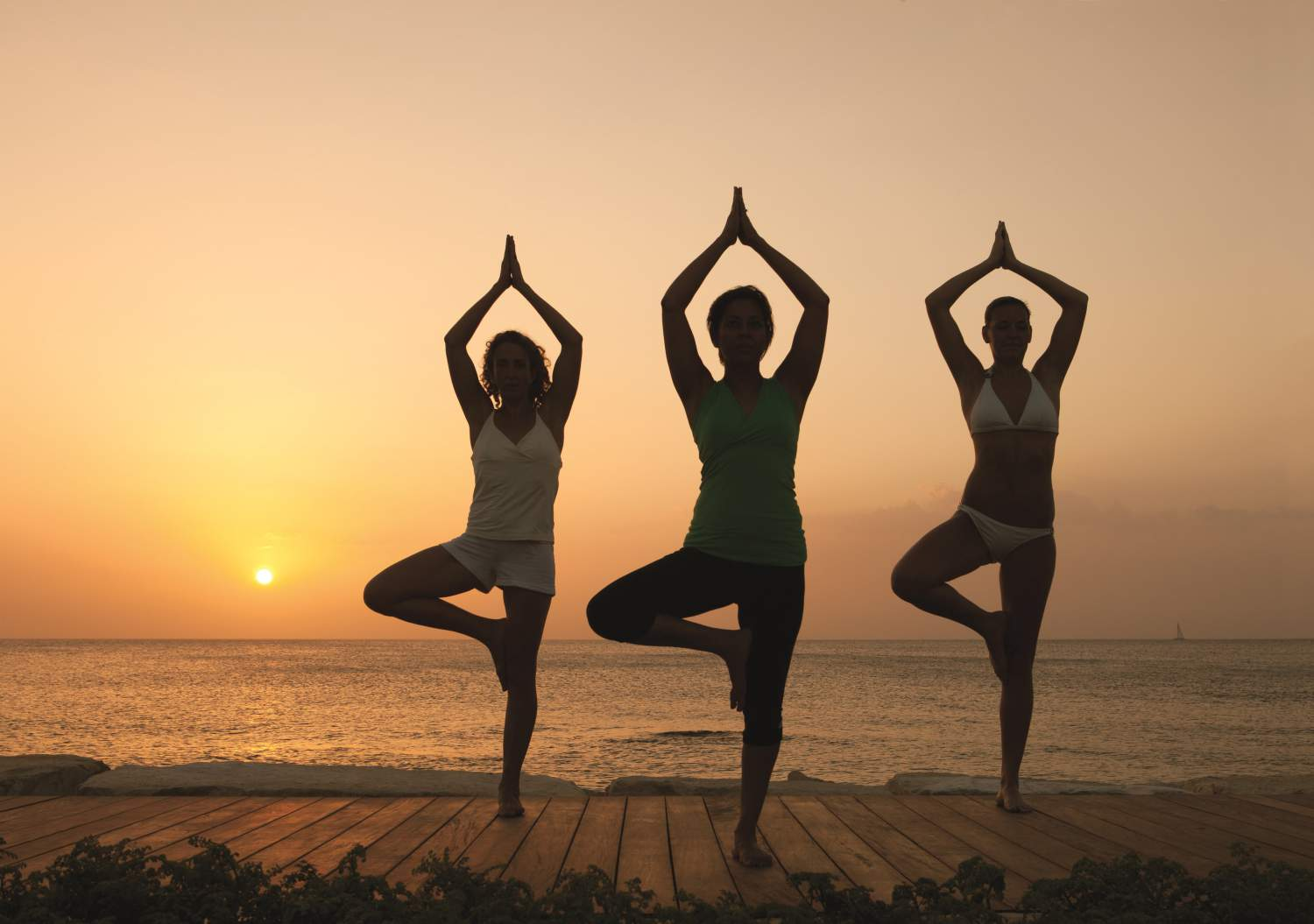 Have a yoga session at sunset