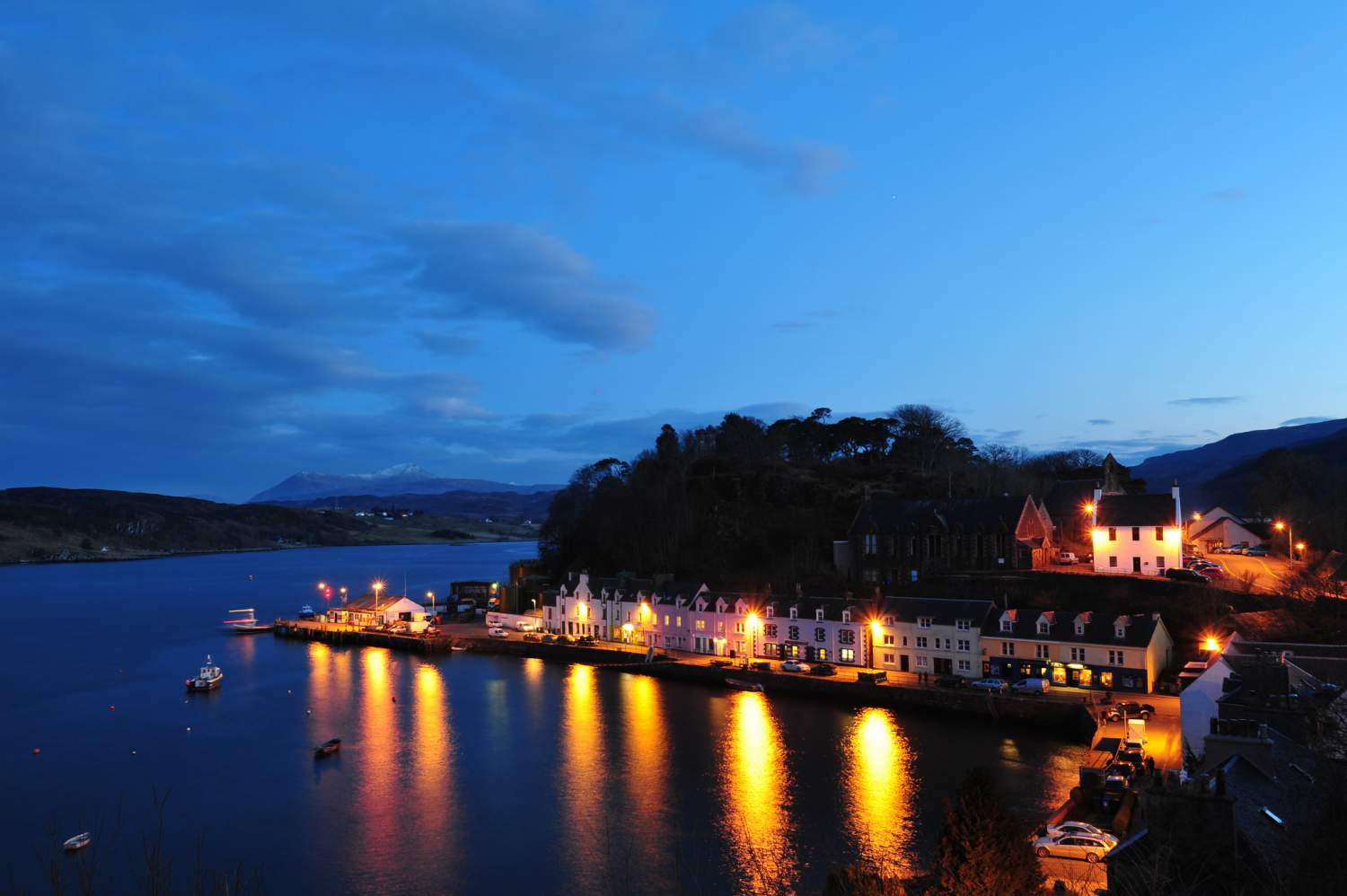 Night view of Portree village on Skye Island in Scotland