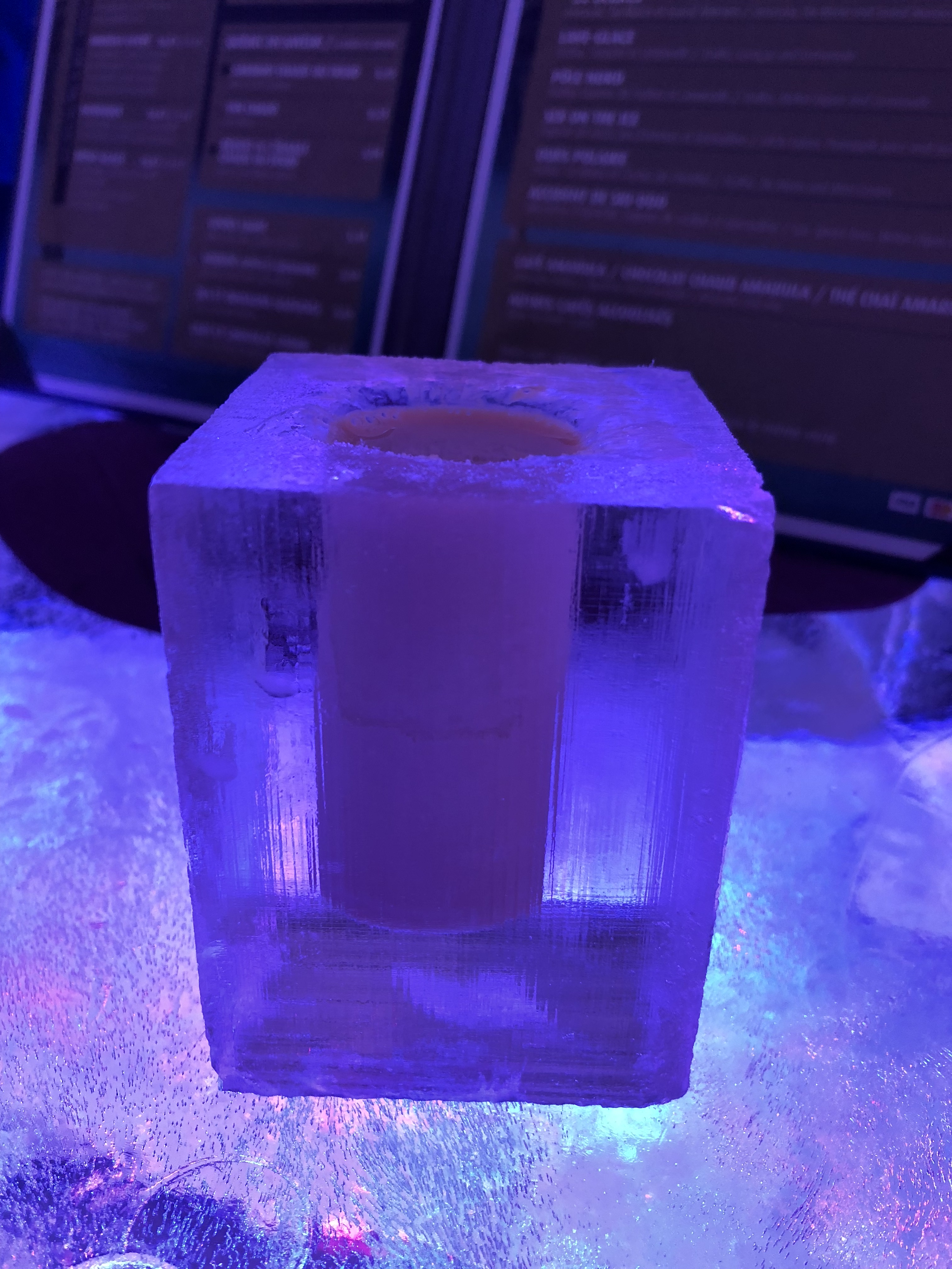 Cocktail in an ice glass at Hôtel de Glace in Quebec