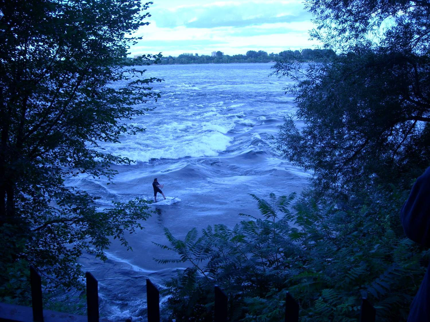 Surfer on St-Lawrence river in Montreal, Canada