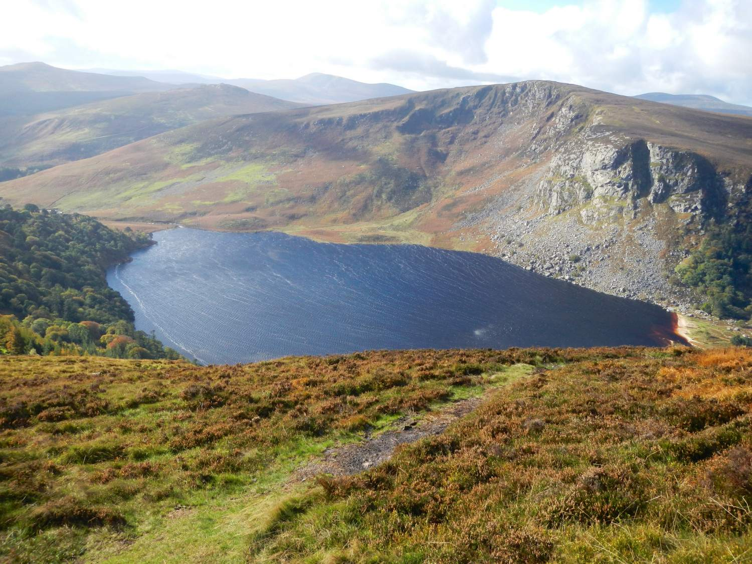 Lough Tay lake seen from the path on the Wicklow mountains, Ireland
