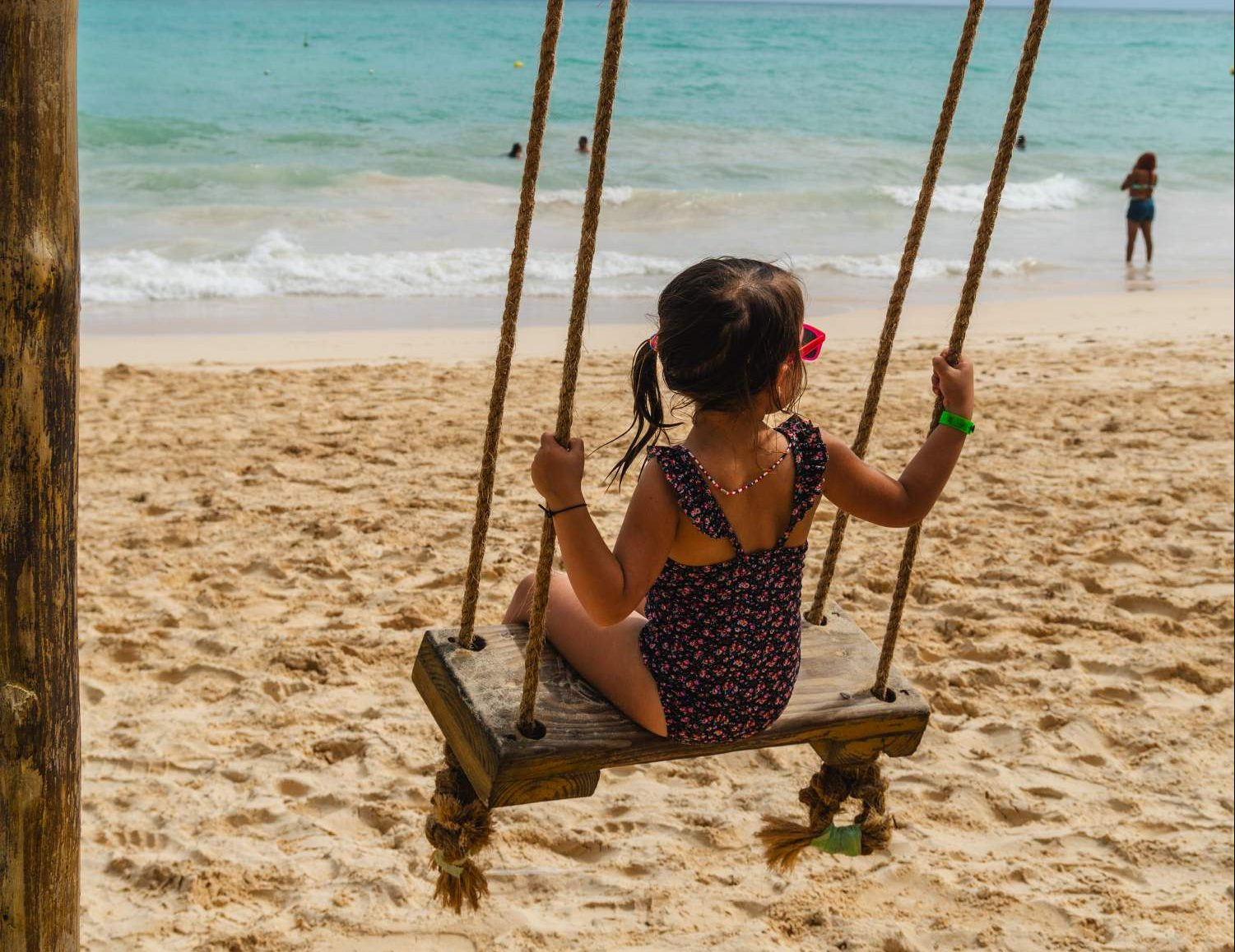 Swinging on the beach in Dominican Republic